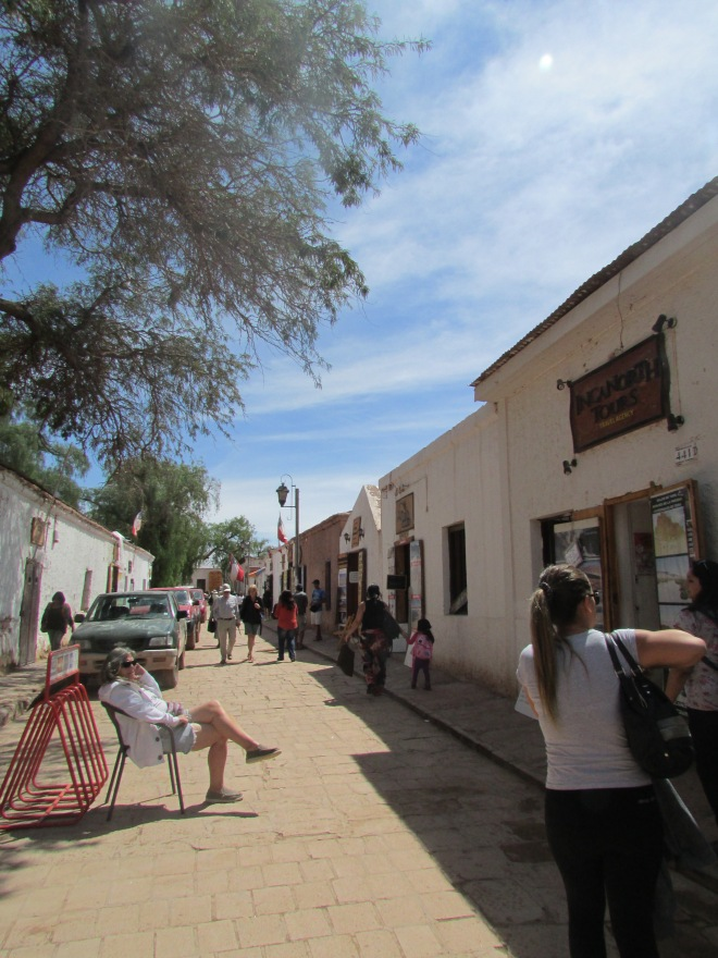 Almost every street like this in San Pedro is lined with Tour Companies.